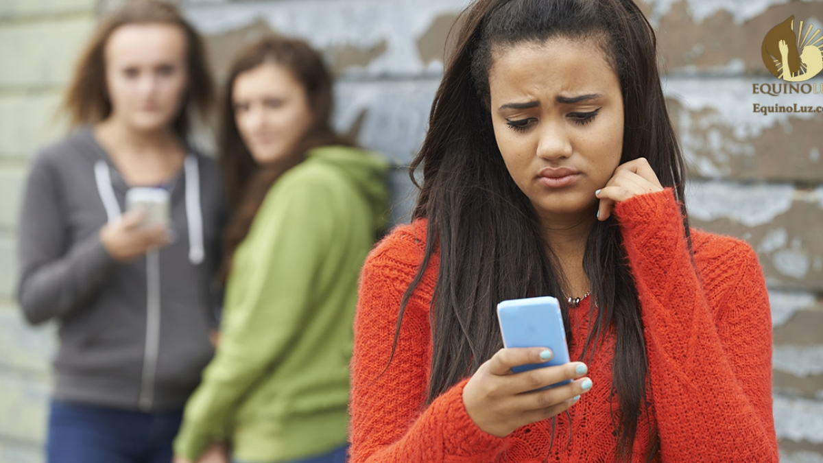 45009248 - teenage girl being bullied by text message